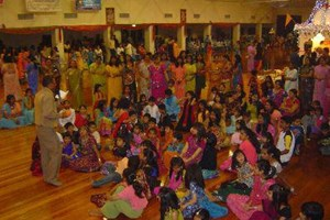 The audience eagerly awaits the start of the dance
