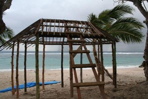 A beach fale being rebuilt by the young team