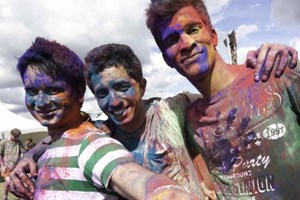 Blokes soak up the sun and some colour at the HUMM 106.2 FM Holi celebration